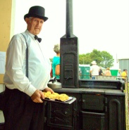 Brian Golding of the Franklin Historical Society bakes scones in a cast iron oven.