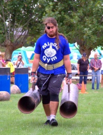 Dean Sinclair aka 'Powerlifting Jesus' makes light work of the farmer's walk.