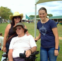Sandra Hodgson, Ross Gillard and Chelsea Holm enjoy the donkey judging.