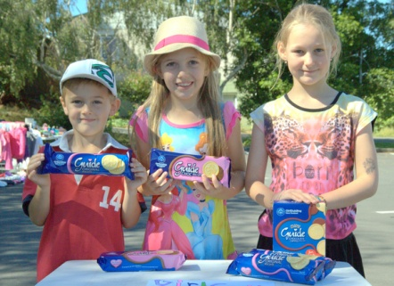 Devon, Amy and Xanthe selling Girl Guide biscuits at the Franklin Club boot sale.