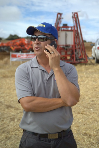Hamish Lim of Norwood Farm Machinery makes a deal .