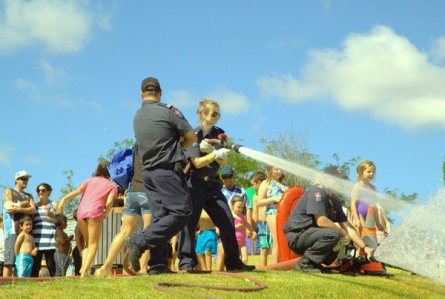 Fire fighter Stuart Harvey, Recruit Fire fighter Jenna Barnett and CFO Scotty Darneil control the water flow.