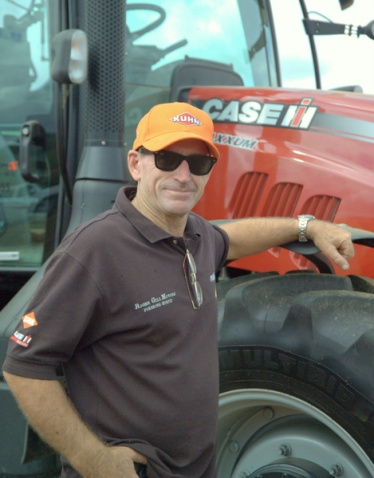Phil Gill of Roger Gill Agriculture admiring a Case tractor.