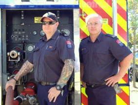 Senior fire fighter Vaughan Wood and Fire fighter Paul Neal man the pumps.