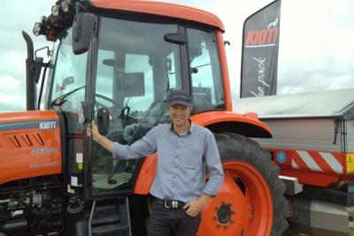 Scott Briggs of PowerFarming proudly displays a Kioti tractor.