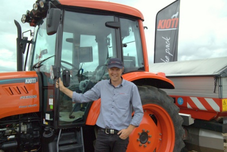 Scott Briggs of PowerFarming proudly displays a Kioti tractor.