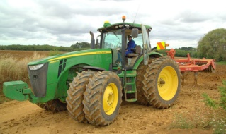 Anil Wallabh plowing up the fields.